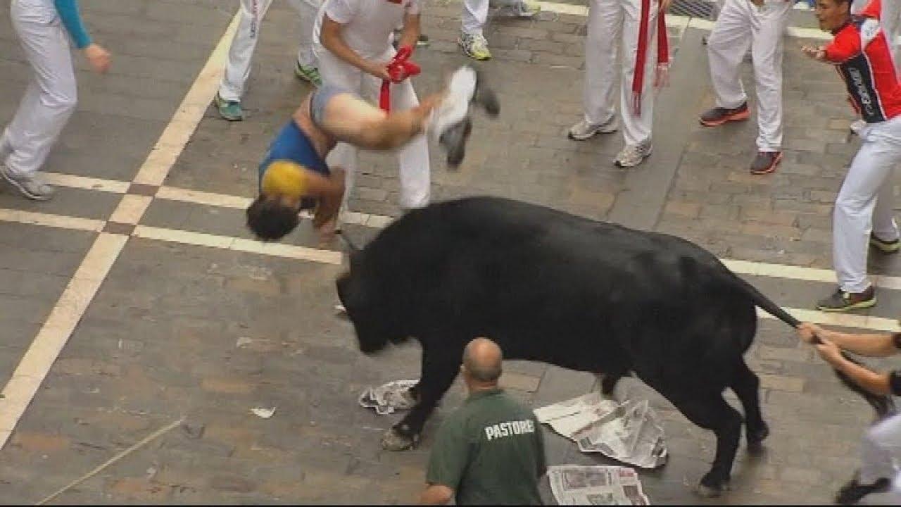 Spanish Bull Runners Moment a Bull-runner Gets