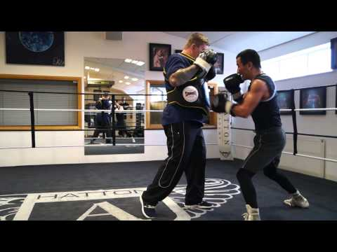 Zhanat Zhakiyanov on the body belt with Ricky Hatton