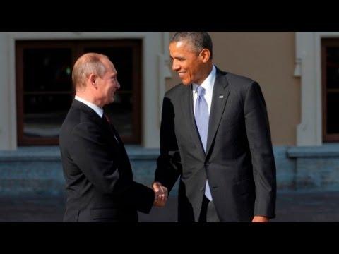 Obama and Putin greet with long handshake