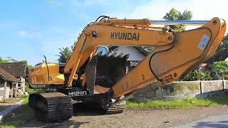 Excavator And Compactor Transport by Fuso Self Loader Truck Hyundai RH210 Volvo EC210B