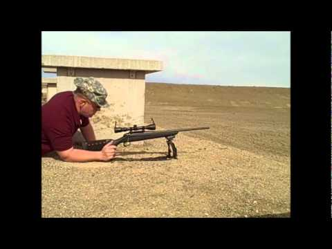 SHOOTING AT 100 YARD .75 INCH TARGET IN HIGH WINDS (REMINGTON 770)