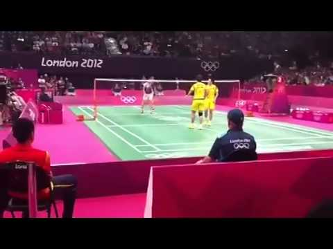 A video shows the Korean and Chinese badminton players try to lose in London Olympics