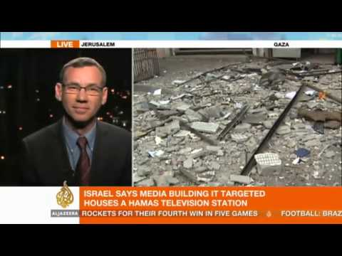 Israel defends air strikes that hit media building