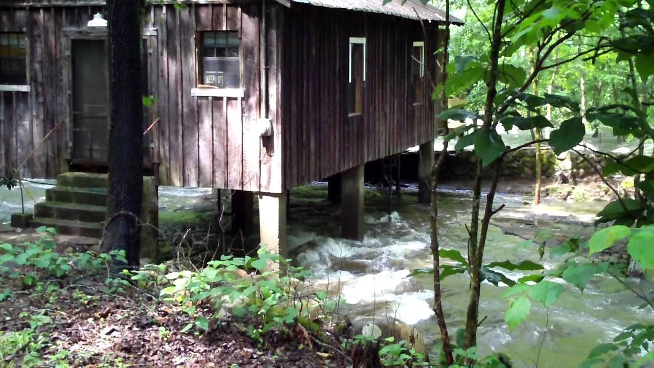 Water Flowing Under Cabin Little Pigeon River In Pittman