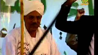 Singer Mahmoud Abdel Aziz dancing the Sudanese President