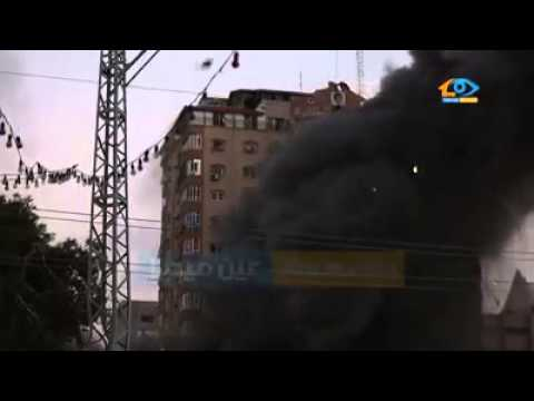 Israeli missiles destroy a 12 level residential building in Gaza city