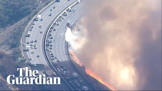 California: aerial firefighting crews tackle blaze near Simi Valley highway