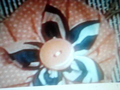 florecita hecha por la Sra sonia franco con tela animal print    140.MPG