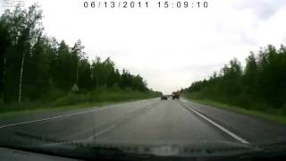 Crash with a lorry on a wet highway in Russia