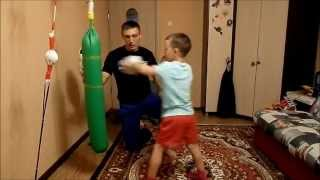 Boxing. work with the child on a Boxing bag