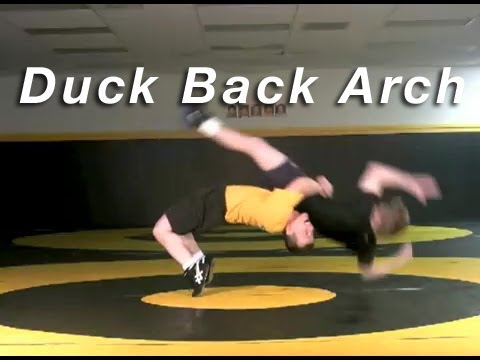 Duck Under to Back Arch KOLAT.COM Wrestling Techniques Moves Instruction Image 1