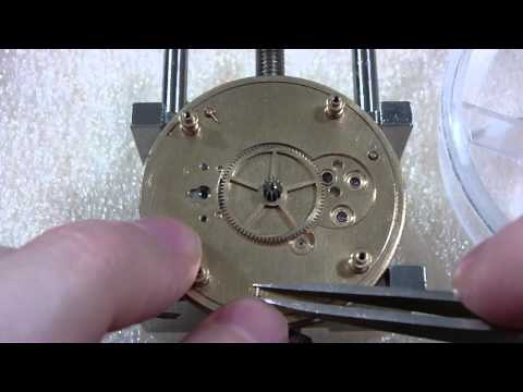 How I take apart a pocket watch and repair ratchet wheel. Elgin