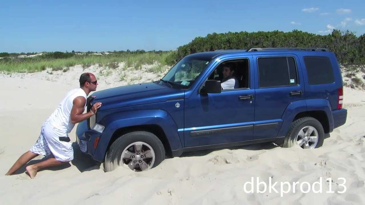 Diesel jeep liberty crd pulling out stuck jeep on beach youtube