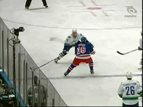 Aaron Rome hipchecks Sean Avery