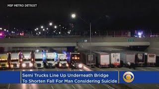 Semi Trucks Line Up Under Bridge To Prevent Suicide