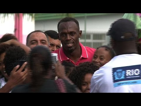 Usain Bolt tours Rio favela sports area