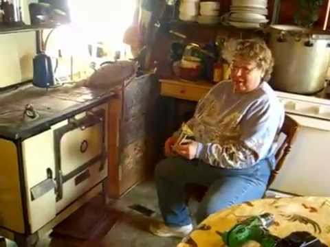 Jackie Clay - Cleaning the wood cook stove