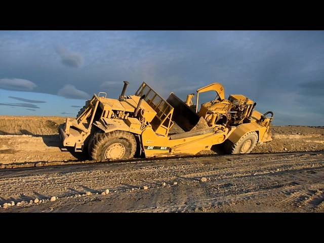 Caterpillar 657 Dirt Sharks Sloping a Bank