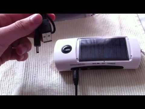 Solar charger with flashlight and fm radio miniinthebox