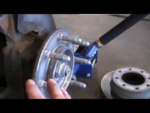 How to install replace front brakes chevy silverado gmc for 2001 chevy silverado window motor replacement