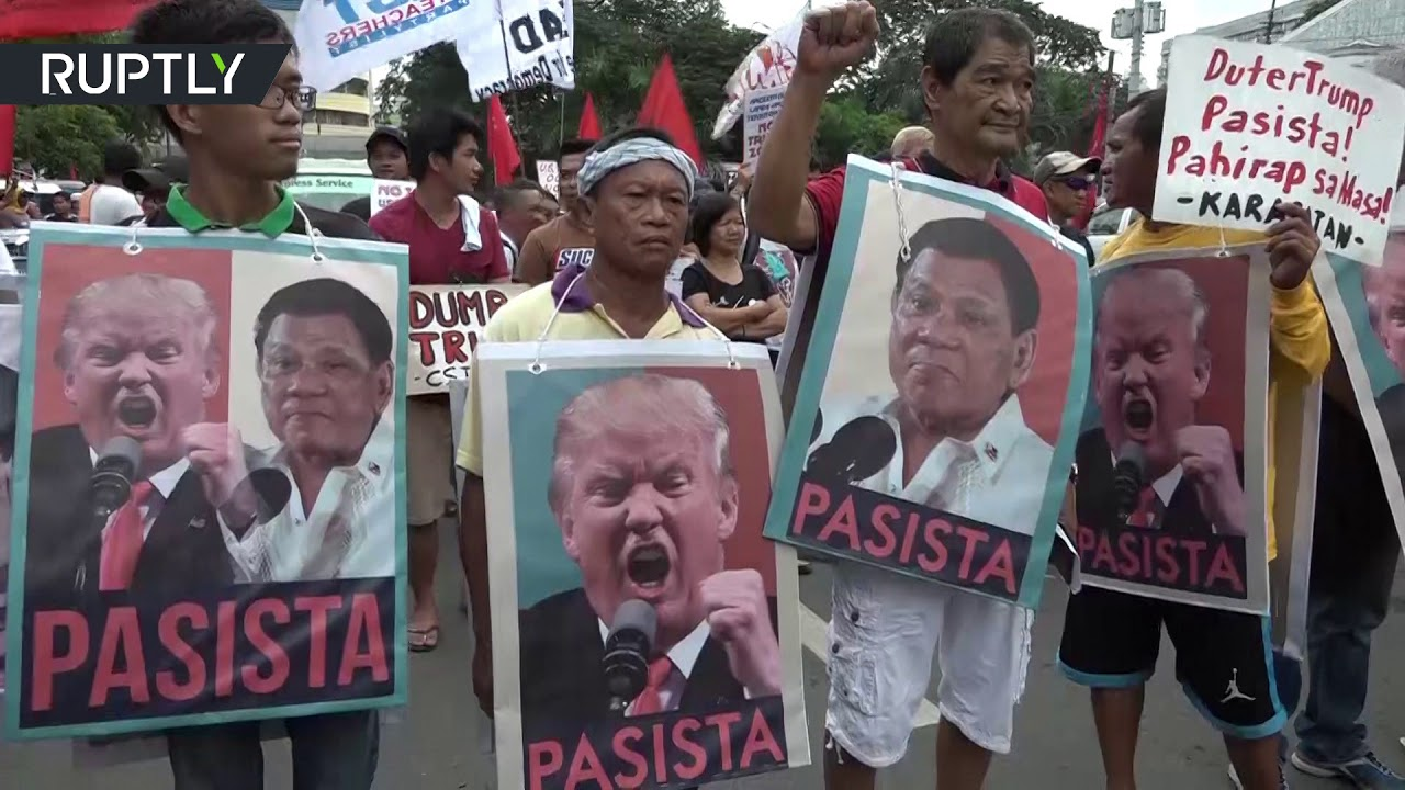 'No War! No Trump!' Protesters clash with riot police ahead of Trump's visit to Philippines