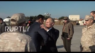 Syria: Putin meets Assad at Russian military base in surprise visit to Syria