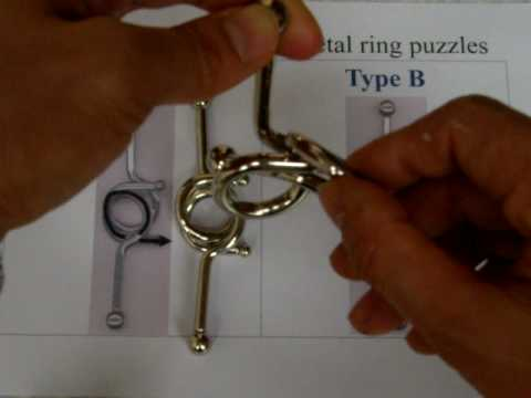 Third version of double 8 metal ring puzzle