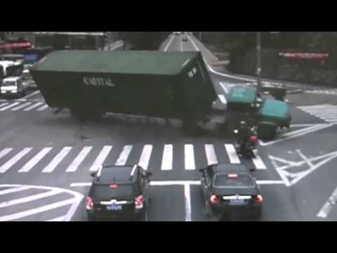 Lucky Biker Nearly Crushed by Truck