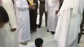 IMAM of Masjid Al Haram waits for a boy to finish salah to meet him