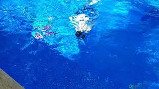 Kye jumping in pool