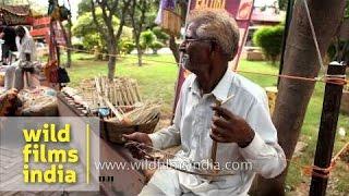 An old man sells 'Ektara' outside Dilli Haat, Delhi