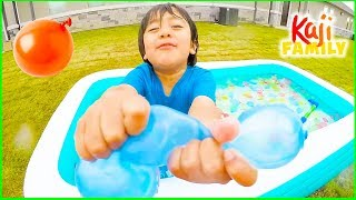 Ryan Plays inflatable water toys with Mommy!