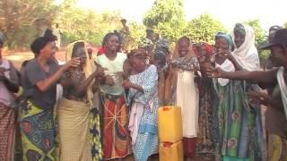 Women Coop in Guinea dancing for clean water
