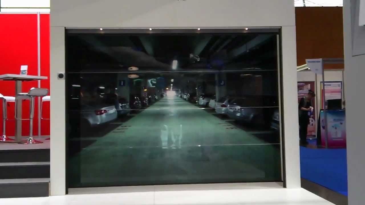 Porte de garage trompe l 39 oeil sda salon nordbat 2012 youtube - Trompe l oeil de porte ...