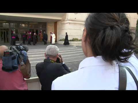 Greeting Pope Francis at Catholic Church's historic synod