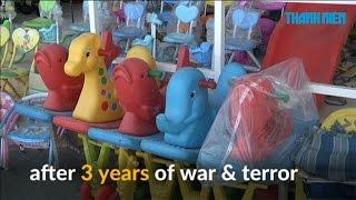 IS chạy, búp bê và  đồ chơi trở lại với trẻ em Iraq