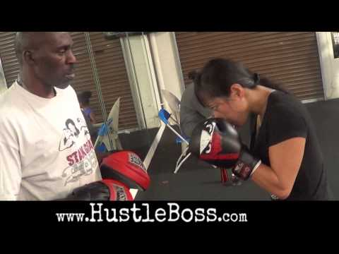 Roger Mayweather showing off his mitt work with Don Moore, Ton Jones, and Gaia