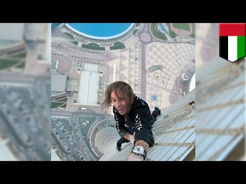 French Spiderman climbs skyscraper: Extreme urban climber Alain Robert scales Dubai's Cayan Tower