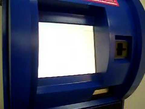 Returning a film to a Movie Booth DVD rental kiosk