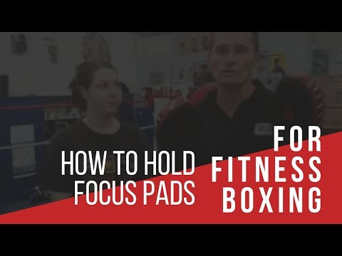 How to hold focus pads for fitness boxing Image 1