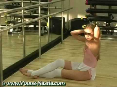 Sweet flexible gymnast stretching in the Ballet Sallon