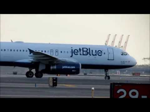 JetBlue Airways A320-232 Taxiing and United Airlines Boeing 737-700 Takeoff at Newark Airport
