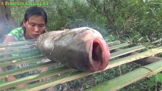 Primitive skills catch big fish at river by hand and cooking fish recipe - Eating delicious
