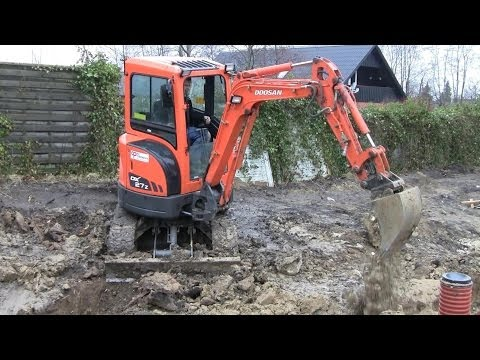 Doosan DX 27 mini excavator, digging a sewer trench, and fooling around @ 3:05 , on a construction site in Denmark. Come and follow us on Facebook... https:/...