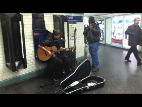 Impromptu duet street performance in the Paris Metro Station