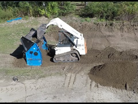 Screening and spreading top soil