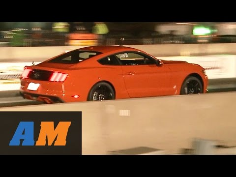 2015 Mustang EcoBoost Stock 1/4 Mile vs. 2014 Mustang V6 Drag Race by AmericanMuscle.com