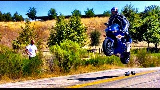 GSXR1000 goes off jump and lands doing a wheelie