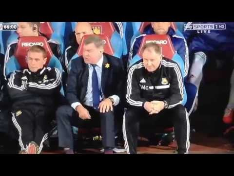 Neil McDonald Scratching his balls then being told off by Sam Allardyce.
