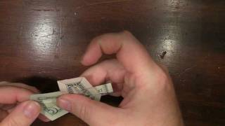Origami Cross With A Us Five Dollar Bill
